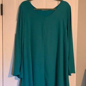 Teal color dress.
